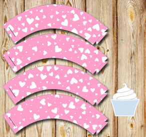 Light pink cupcake wrappers with white hearts  | Free printable for Valentines day